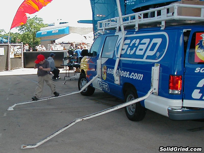 A kid sliding on the Soap Van