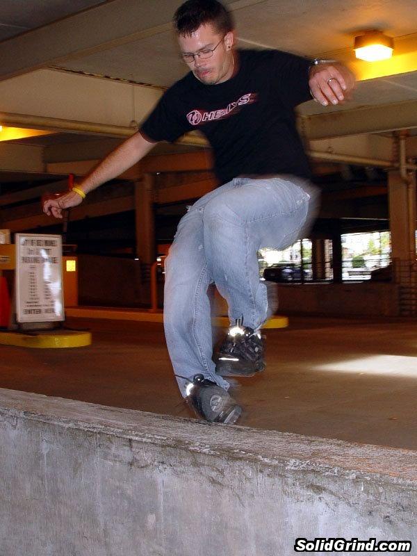 Zach larson with a Christ Grind in a Des Moines parking garage