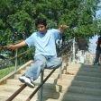 Victor Sierra sticking a Sidewalk on the John Bowne School rail